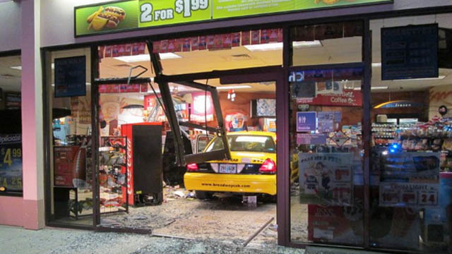 Taxi crashes into store after confrontation with rider