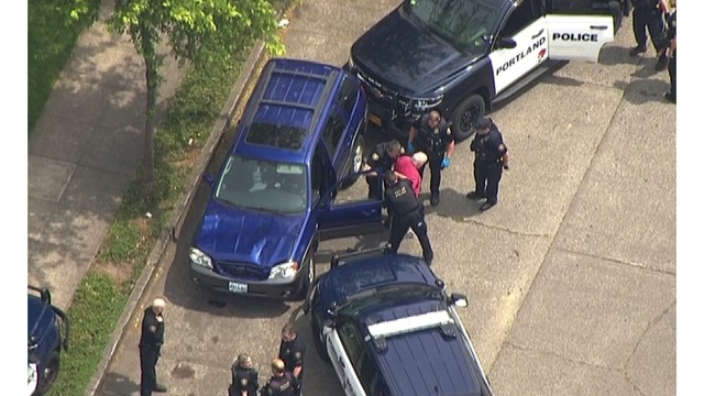 Police surround car suspected in hit-and-run crash at PSU in NE Portland.