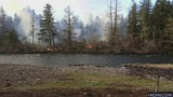 Evacuation levels lowered for Santiam Park Fire