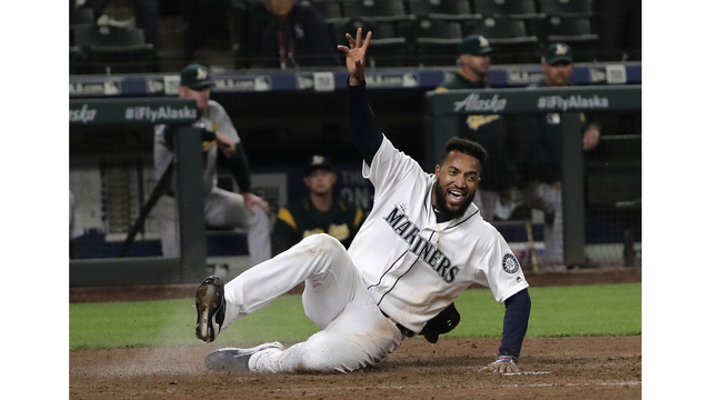 Mariners rally with 2 runs in 10th to beat A's